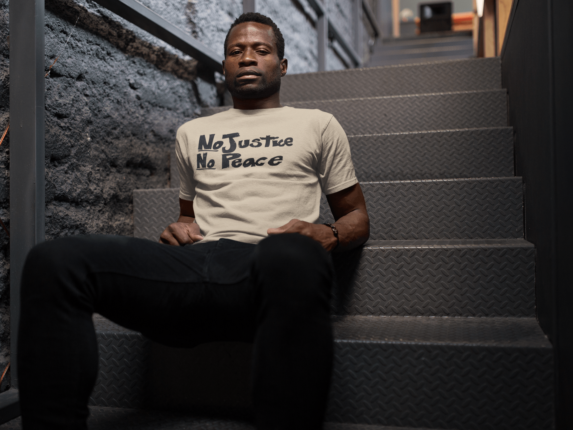 black-man-sitting-on-stairways-while-wearing-a-tshirt-mockup-a17166