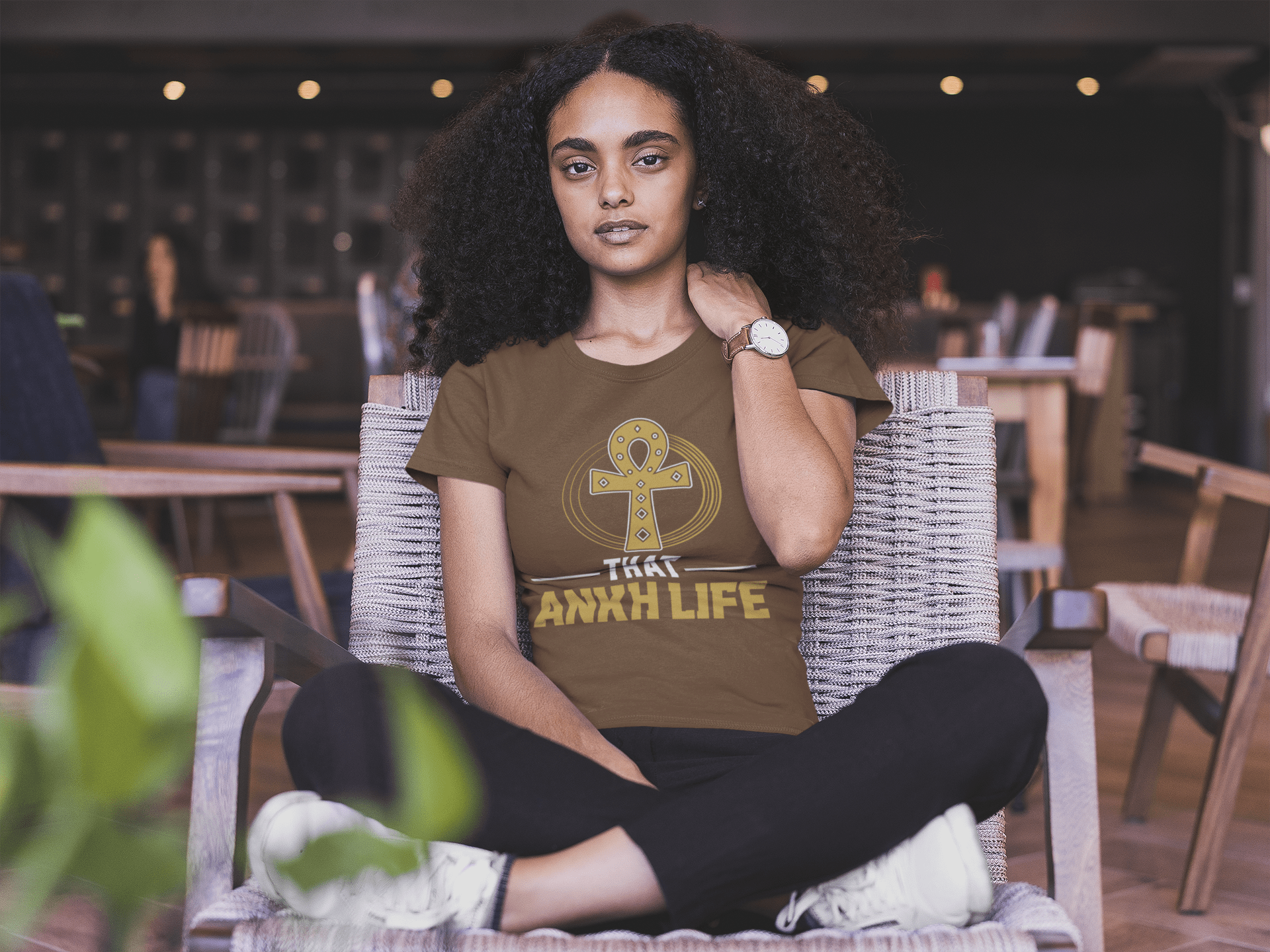 black-woman-wearing-a-tshirt-mockup-sitting-on-a-wooden-chair-a20417