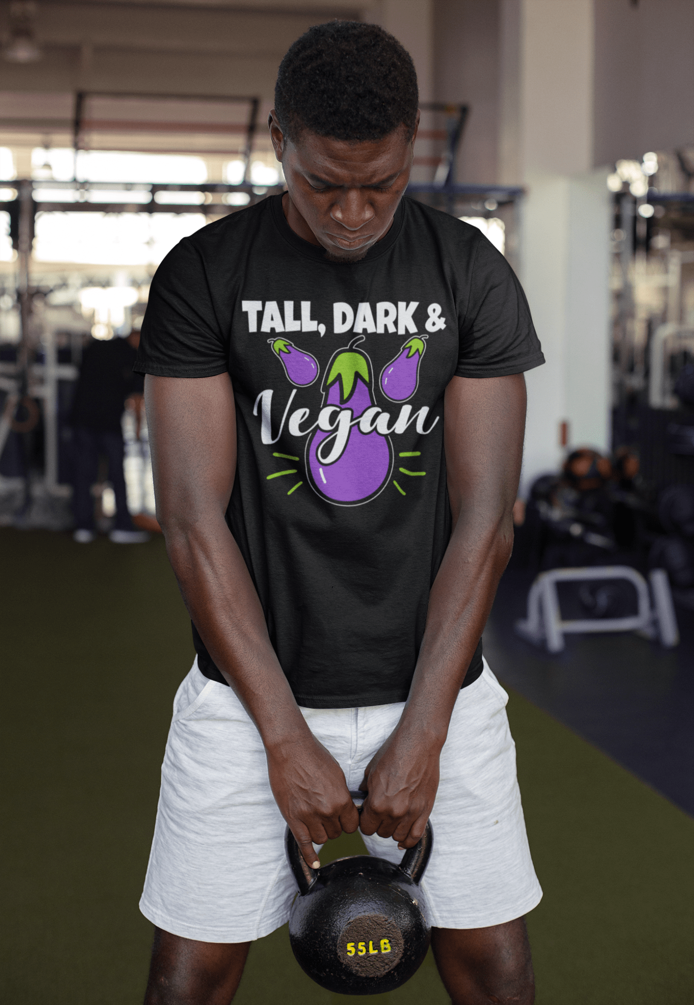 round-neck-tee-mockup-of-a-strong-man-holding-a-kettlebell-at-the-gym-23641